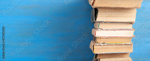 Old books on the blue wooden background.
