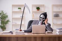 Devil Businessman Employee Sitting At Workplace