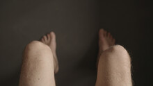 Man Sitting With Naked Legs Indoor
