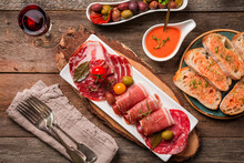 Spanish Tapas And Red Wine On Wooden Table, Top View