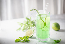 Summer Green Drink, Lemonade With Lime, Basil And Ice In A Glass