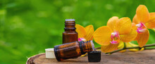 Massage Oil And Stones With Yellow Orchid. Natural Oils.