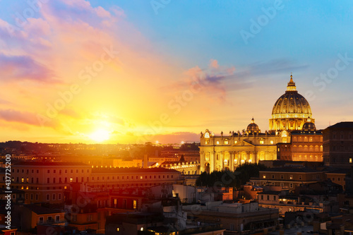 Fotografie, Obraz Cityscape view of Rome at sunset with St Peter Cathedral in Vatican