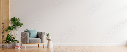 Living room interior room wall mockup in warm tones,gray armchair on wooden flooring.
