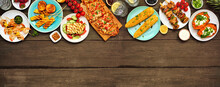 Summer BBQ Grill Top Border Over A Dark Wood Banner Background. Grilled Flatbread, Chicken And Shrimp Skewers, Stuffed Sweet Potato, Corn, Fruit And Salad. Above View With Copy Space.