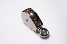 Metal Steel Pulley Isolated In White Background Used For Lift Heavy Objects