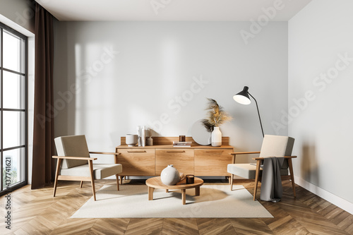Light living room interior with armchairs and drawer with decoration, mockup