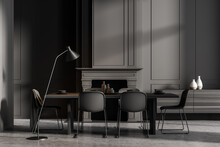 Minimalistic Grey Dining Room Interior With Long Table, Black Chairs And Fireplace