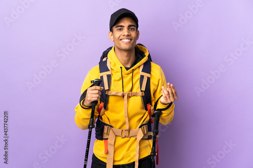 Canvastavla African American man with backpack and trekking poles over isolated background m