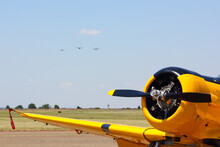 Yellow Aerobatic Aircraft With Formation On Approach, Pretoria, South Africa