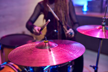 Cymbals Of Drum Kit With Female Musician With Drumsticks On Background
