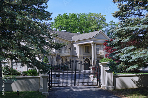 Fototapeta premium The Bridle Path area of Toronto has large gated estates that cost tens of millions of dollars, many of them owned by celebrities or international business tycoons.