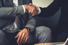 Businessman Handshake With Another Businessman Partner In Modern Workplace Office. People Corporate Business Deals Concept.
