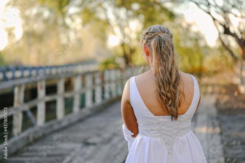 Fototapeta Debutante or Bride, back view of dress and hairstyle