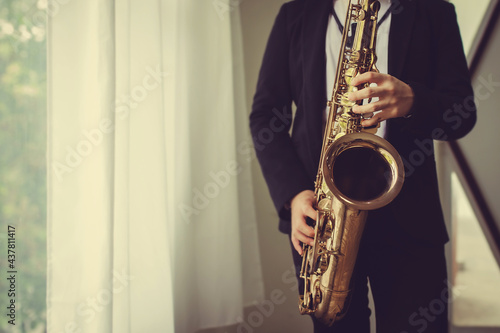 Fotografie, Obraz close up of Young Saxophone Player hands  playing tenor sax musical instrument o