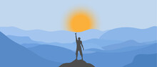 Silhouette Of A Man On Top Of A Mountain And The Sun Rising From Behind The Mountains