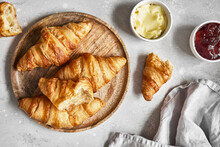 Fresh Sweet Croissants With Butter And Strawberry Jam For Breakfast.