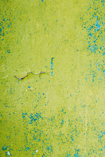 Close View Of Multilayer Dyed And Cracked Flaked Texture Of Blue And Light Green Paint At Surface.