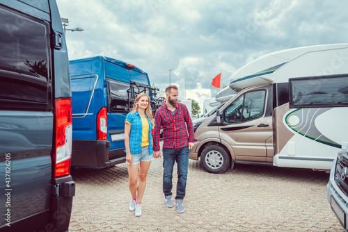 Fotografija Couple facing abundance of choice in camper vans to buy