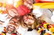 Leinwandbild Motiv Gruppe glücklicher Fußballfans aus Deutschland feiern gemeinsam einen Meisterschaft Sieg