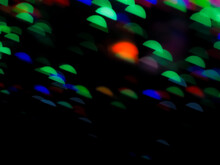 Colorful Blue Green Bokeh Background Happy New Year 2022. Abstract Effect Light Night Out Of Focus Wallpaper. For Christmas Party Celebration Holidays Or Technology Background Concept. Colorful