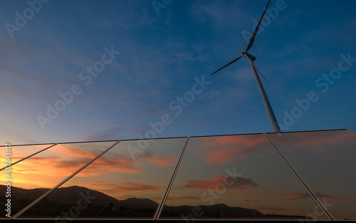 Beautiful sky at sunrise reflecting in photovoltaic panels #437843017