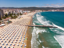 Aerial Photo Of Sunny Beach Central Beach In Bulgaria, Sand Beach, Sunbeds And Sun Umbrellas. Drone View From Above. Summer Holidays Destination