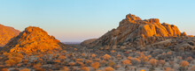 Erongo Mountains In Central Namibia: Panorama Landscape With Eroded Granite Rocks And Hills At Sunrise