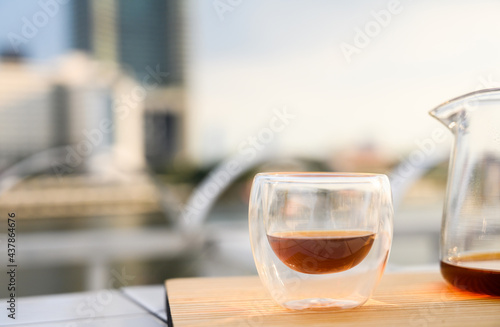 Canvastavla Drip freshly brewed coffee in a cup and glass pot on wooden tray