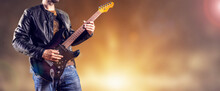 Rock Guitarist Plays An Electric Guitar. Artist And Musician Performs Like Rockstar. Guitar Player Performs On Stage.