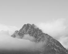 Clouds Surrounding Rocky Mountain Peak. Tryfan Snowdonia Wales.