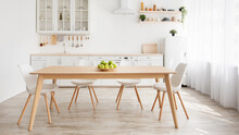 Scandinavian Home Interior. White And Wooden Kitchen Furniture, Plate With Apples On Dinning Table, Panorama
