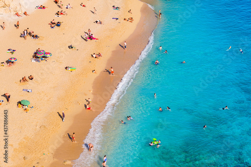 Aerial view on beach and umbrellas. Vacation and adventure. Beach and blue water. Top view from drone at beach and azure sea. Travel and relax video #437886643