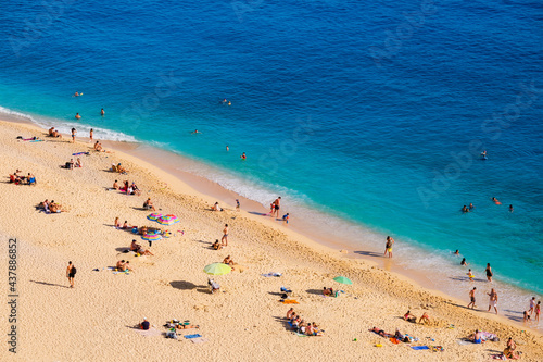 Aerial view on beach and umbrellas. Vacation and adventure. Beach and blue water. Top view from drone at beach and azure sea. Travel and relax video #437886852