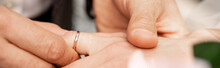 Partial View Of Man Putting Wedding Ring On Finger Of Bride, Banner