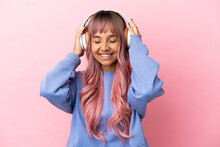 Young Mixed Race Woman With Pink Hair Isolated On Pink Background Listening Music