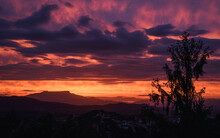 Beautiful Red Sunset With Clouds Overlooking The Montseny Mountain In Spain.