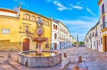 The Potro Square With A Stone Fountain And Triumph Of San Rafael Column, Cordoba, Spain