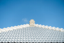 Beautiful White Tiled Roof Under The Blue Sky Of Okinawa