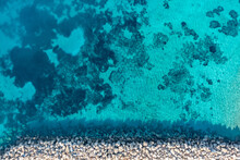 Greece, Cyclades. Aerial Drone View Of A Stone Breakwater On Turquoise Color Sea Water