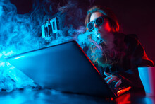 Girl Blogger Vape. Woman Smokes Next To A Laptop. Blogger Girl Smokes During Video Broadcast. Computer Is Handled By A Woman. Hacker Smokes While Working. Computer Geek Fired Smoke From His Mouth