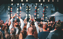 Many Different People At A Concert Listening To Rock Band Music Open Air