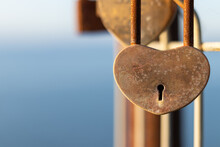 Lock Of Heart And Love On The Old Fence In The City On Coastline.