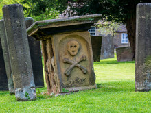Eyam Village Skull And Cross Bones Carving On The Grave Stone