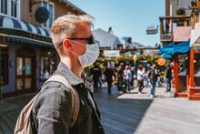 A Masked Man Walks Along Pier 39 Between Shops. San Francisco, USA - 17 Apr 2021
