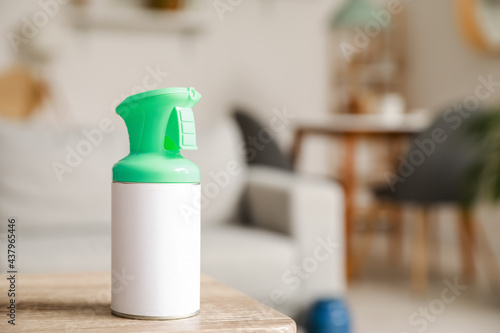 Bottle of air freshener on table in living room, closeup