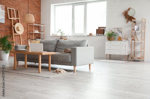 Stylish interior of living room with cozy sofa