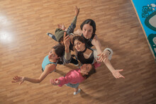 Top View Of Smiling Pretty Urban Dancers, Close-up, Indoors.