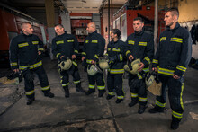 Portrait Of Firefighters Standing By A Fire Engine.