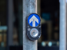 Pedestrian Crossing Button In The Streets Of A Populous City.